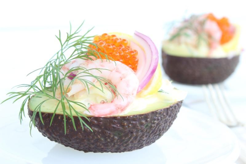 Avocado with egg salad, prawns and caviar