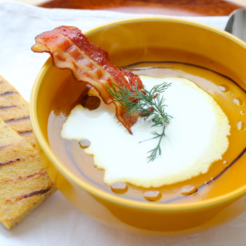 Pumpkin soup with light garlic foam and balsamic syrup