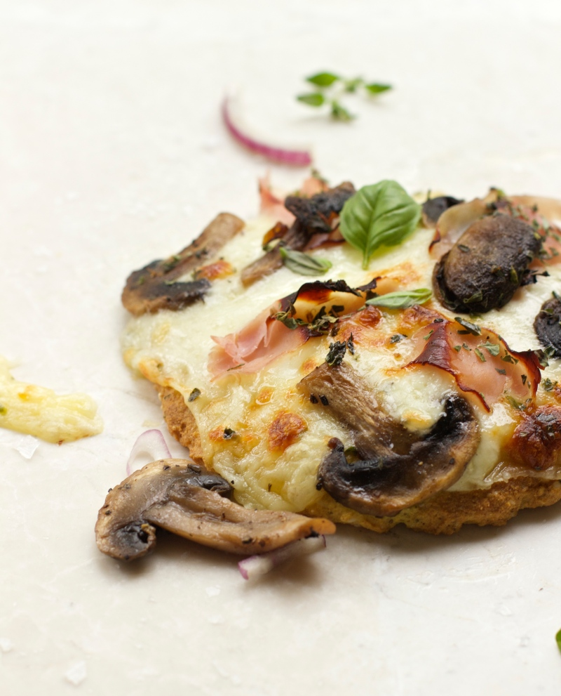 Mini hand pizzas with garlic and mushrooms
