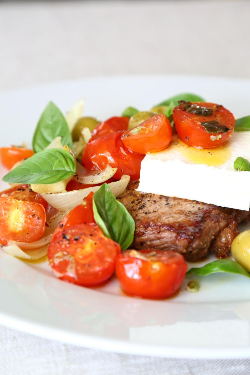Baked tomato salad with feta cheese and sirloin steaks