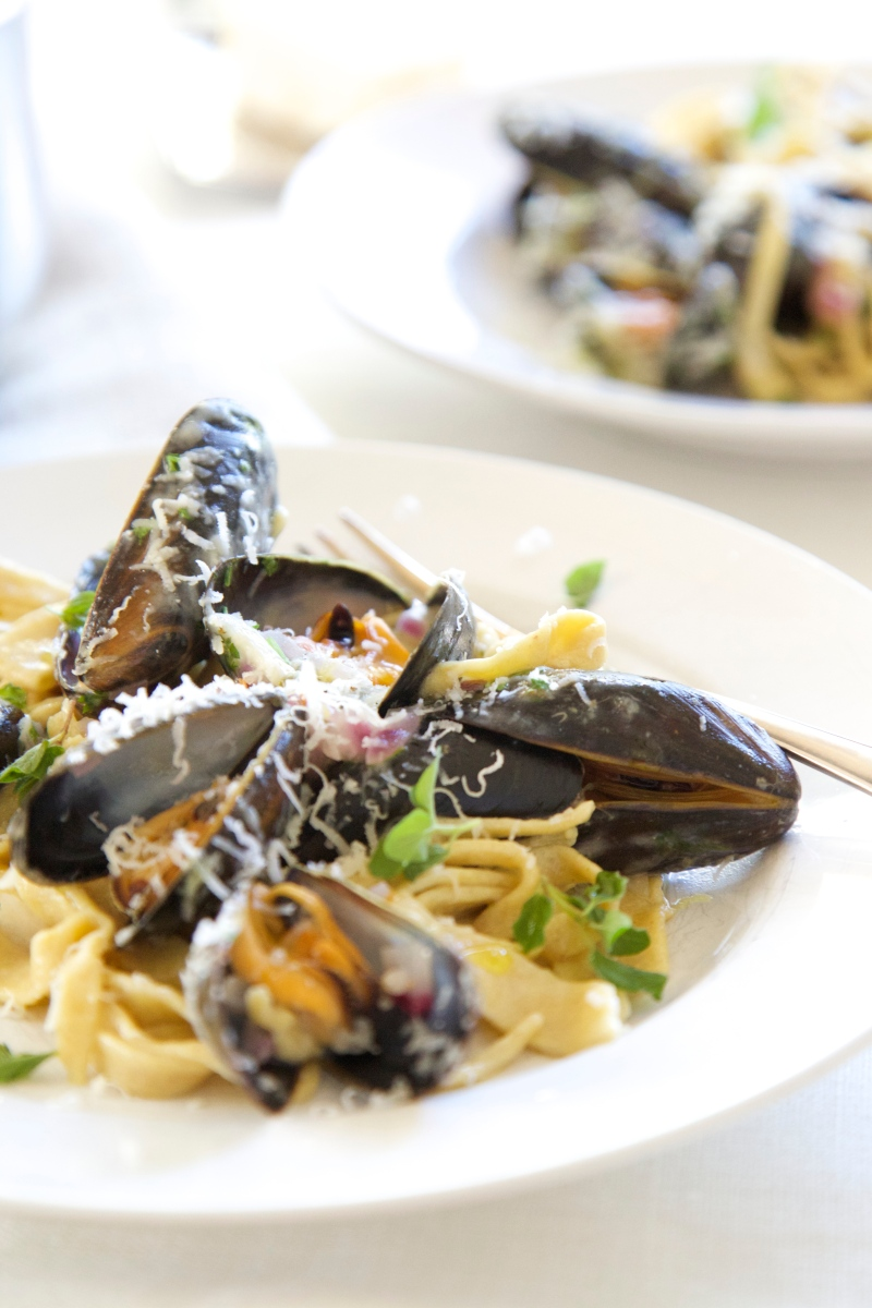 Homemade low-carb and gluten free pasta tagliatelli with white wine steamed mussels