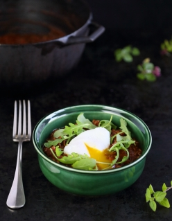 Chili Con Carne with Arugula and Poached Eggs