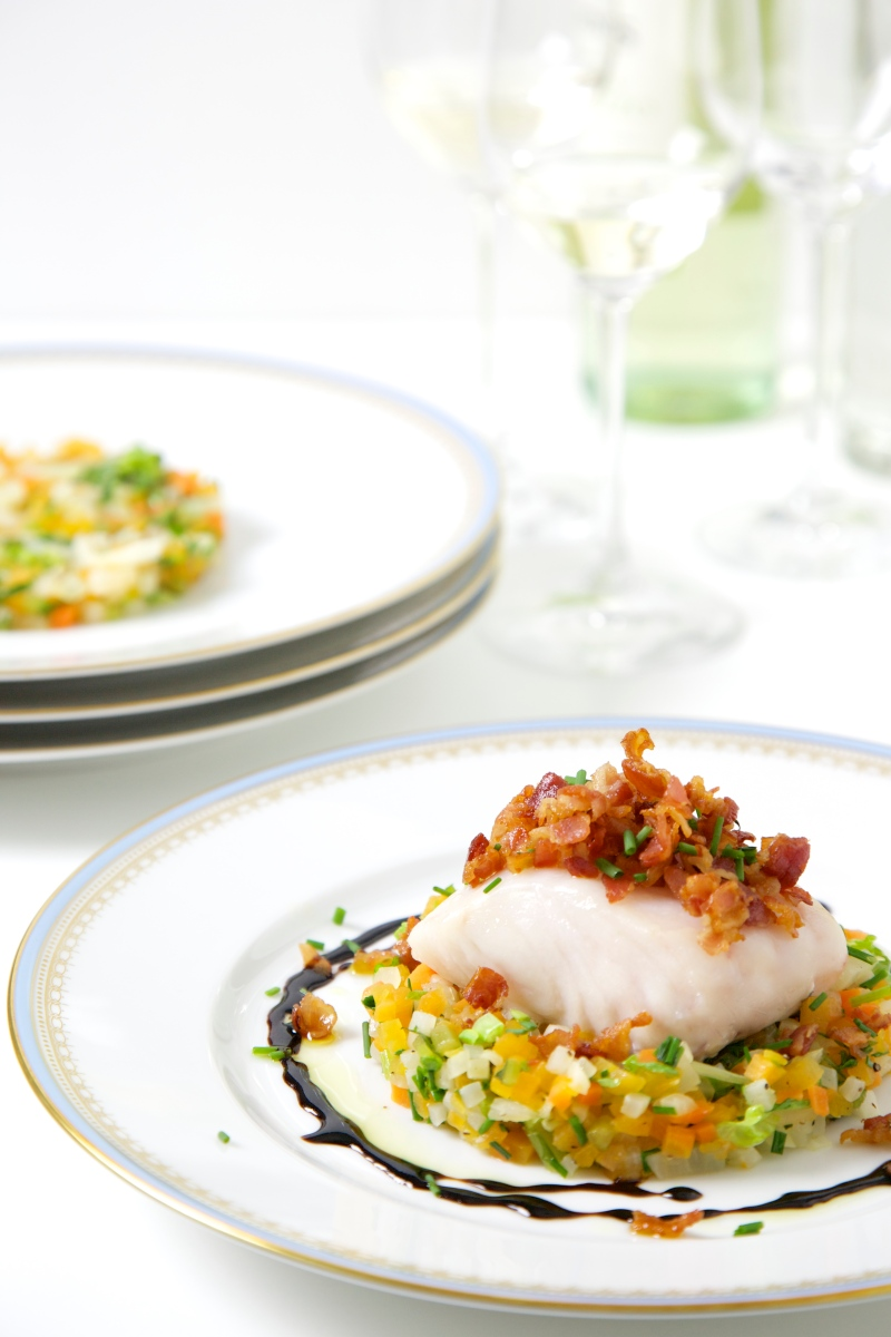 Baked Hake with crispy bacon, balsamic syrup and vegetables